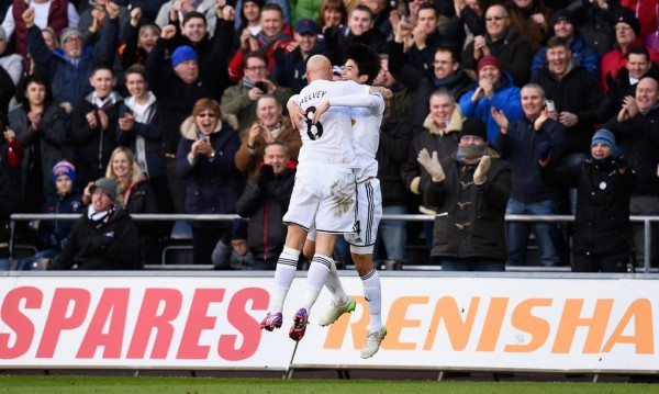 Ki Sung-yeung Celebrates With Jonjo Shelvey at Liberty Stadium. Image: Getty.