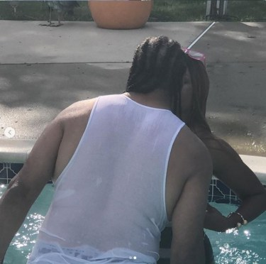 [PHOTOS]: Regina Askia Shows Off Her Banging Body As She Kisses Her Man In The Pool