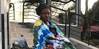 The unnamed Nigerian woman in front of the consulate at Sandton, South Africa on Friday.
