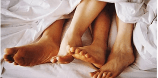 File photo of a man and a woman in bed