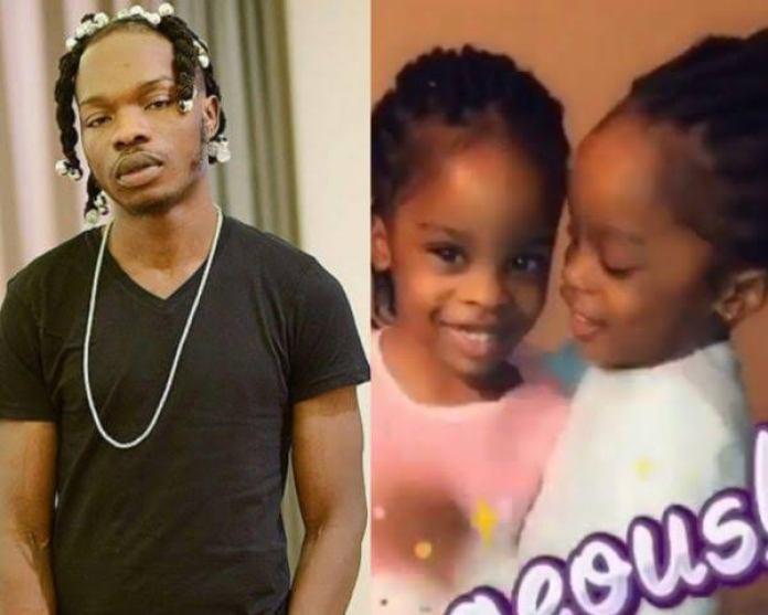 Naira Marley and his daughters
