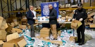 Galician regional vice president Alfonso Rueda (left) visiting the warehouse of a company where sanitary equipment was stolen in Santiago de Compostela, SpainXUNTA DE GALICIA/AFP via Getty Images