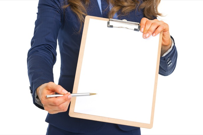 Closeup on business woman giving clipboard for sign_6135612227816607611