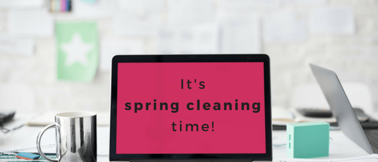 Color photo of a laptop with screen inscription: ''It's spring cleaning time!''