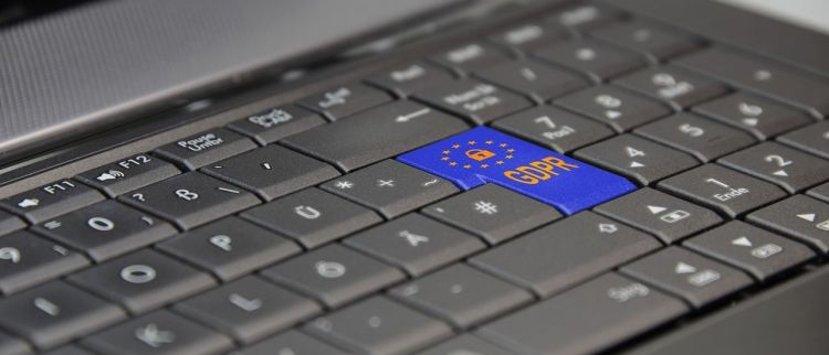 Color photo of a laptop keyboard with GDPR inscription instead of ENTER button.