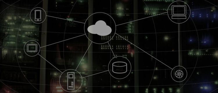 Color photo of of a cloud with connections to computer, smartphone, database icons - used to illustrate the meaning of connected computing.