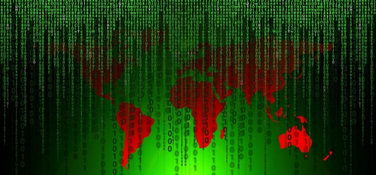 Color photo of world map covered with data used to illustrate the meaning of malware spreading around the world.
