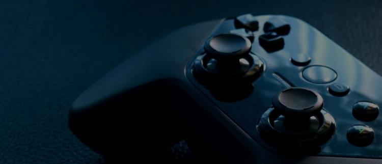 Color photo of a black gaming controller used to illustrate the meaning of gaming and cyber security risks.