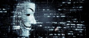 Color photo of an anonymous hacker, used to illustrate the meaning of hacktivism.