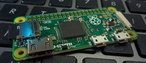Color photo of a Raspberry Pi on a computer keyboard.