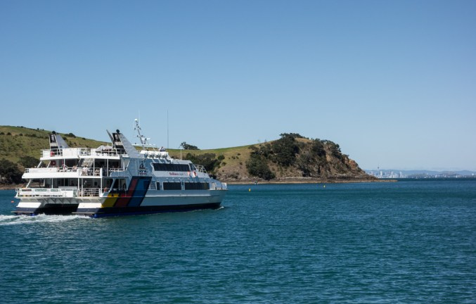 Fast ferry with Auckland in the background.