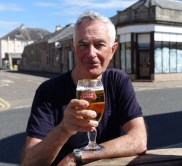 Enjoying a beer in sunny Nairn.