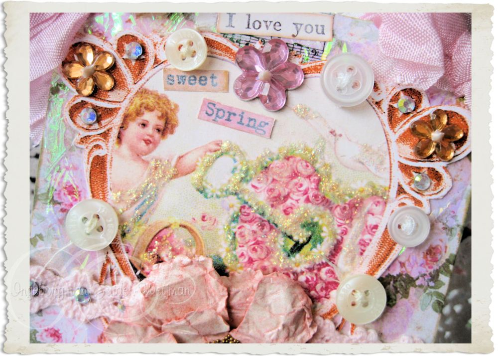 Details of vintage spring angel with MOP buttons and florals