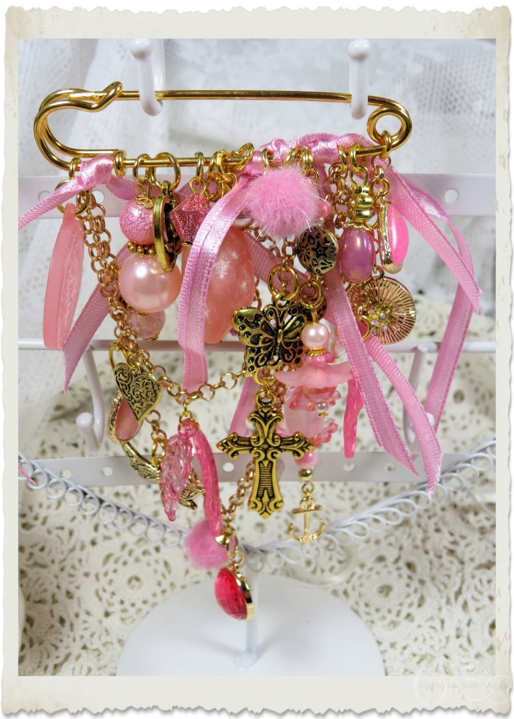 Pink gold brooch with charms and beaded dangles by Ingeborg van Zuiden