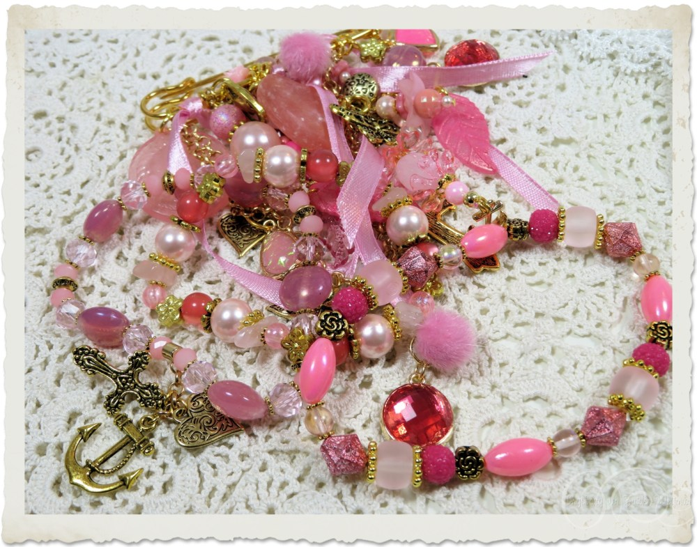 Set of bracelets and brooch in pinks and gold