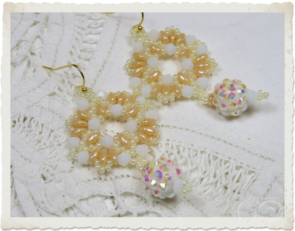 White creme wreath earrings with bicone beads