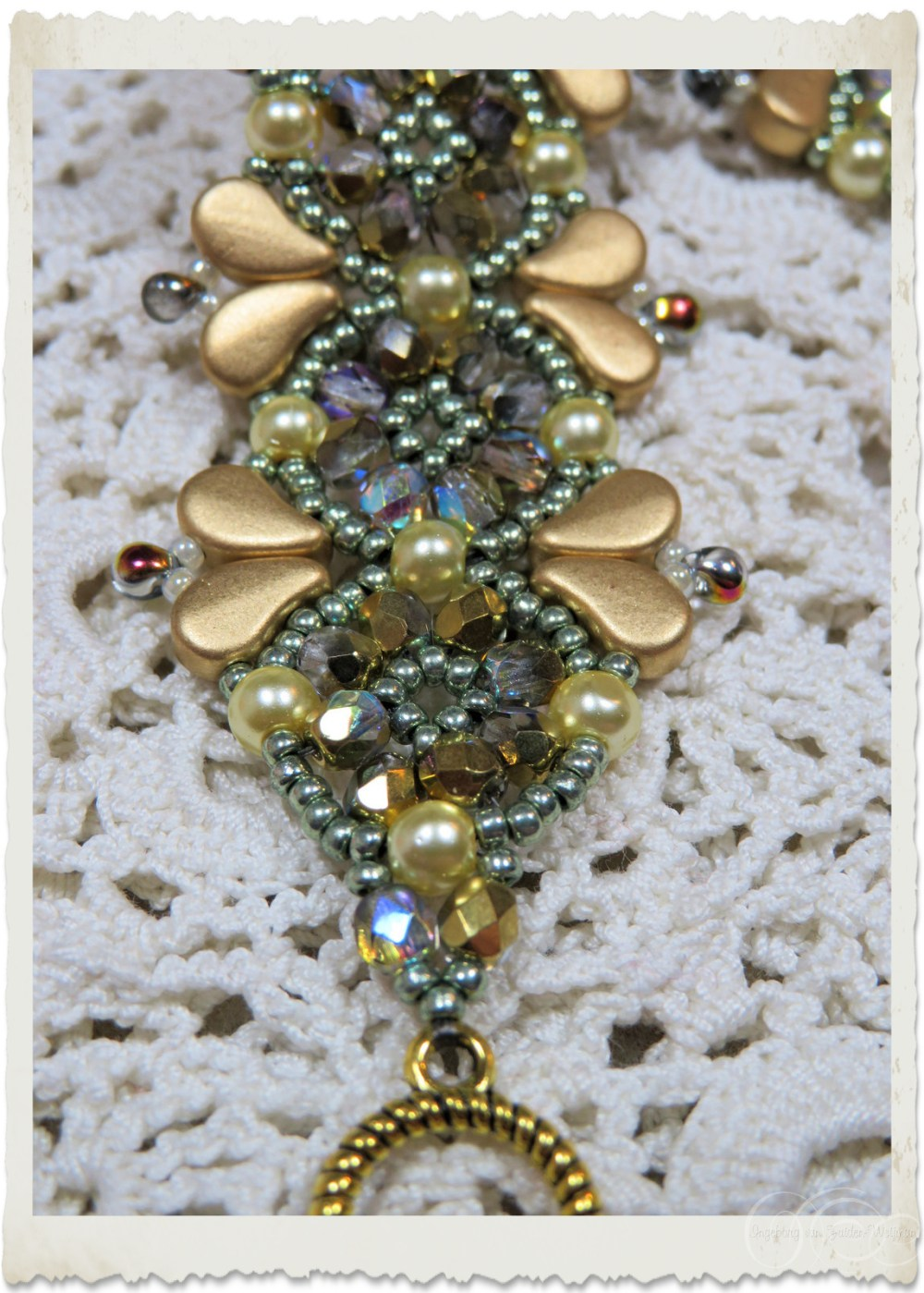 green gold bracelet details with pearls