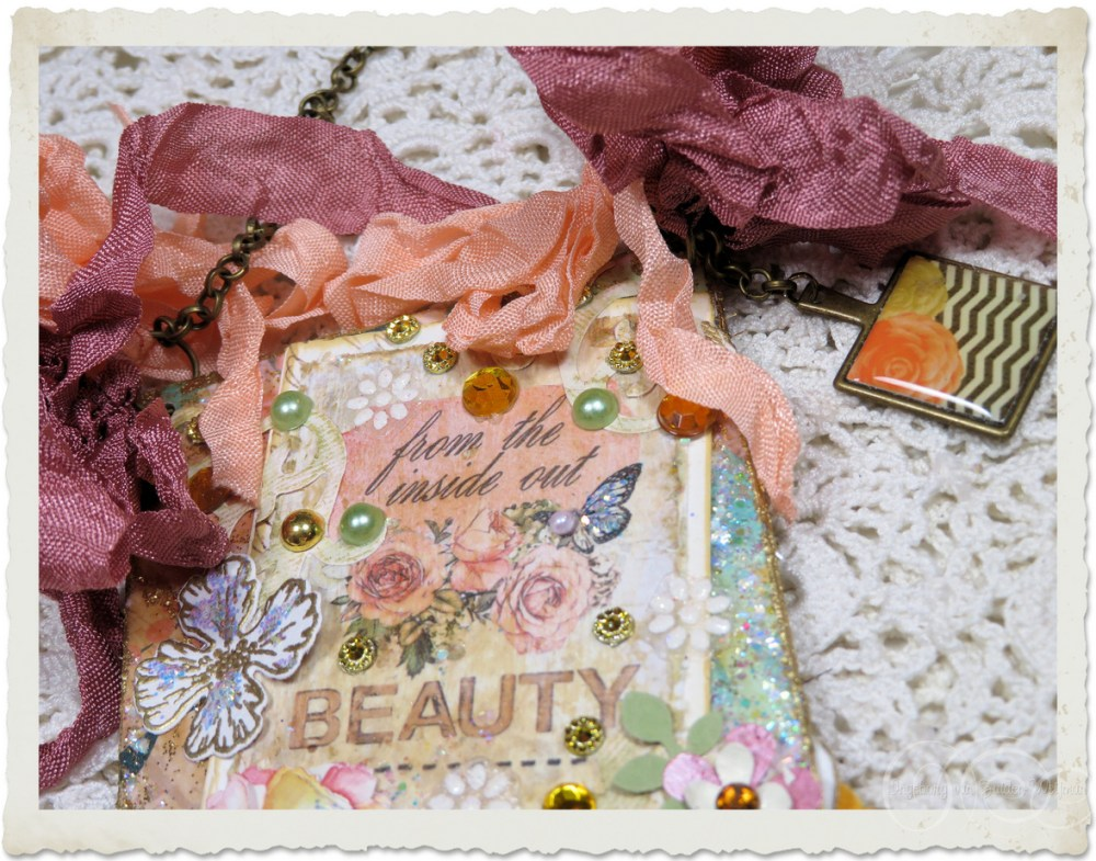 Details of peach ribbons and paper art dietcuts
