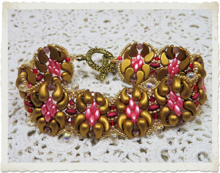 Gold pink duo bead bracelet with Miyuki seed beads and iridescent drop beads