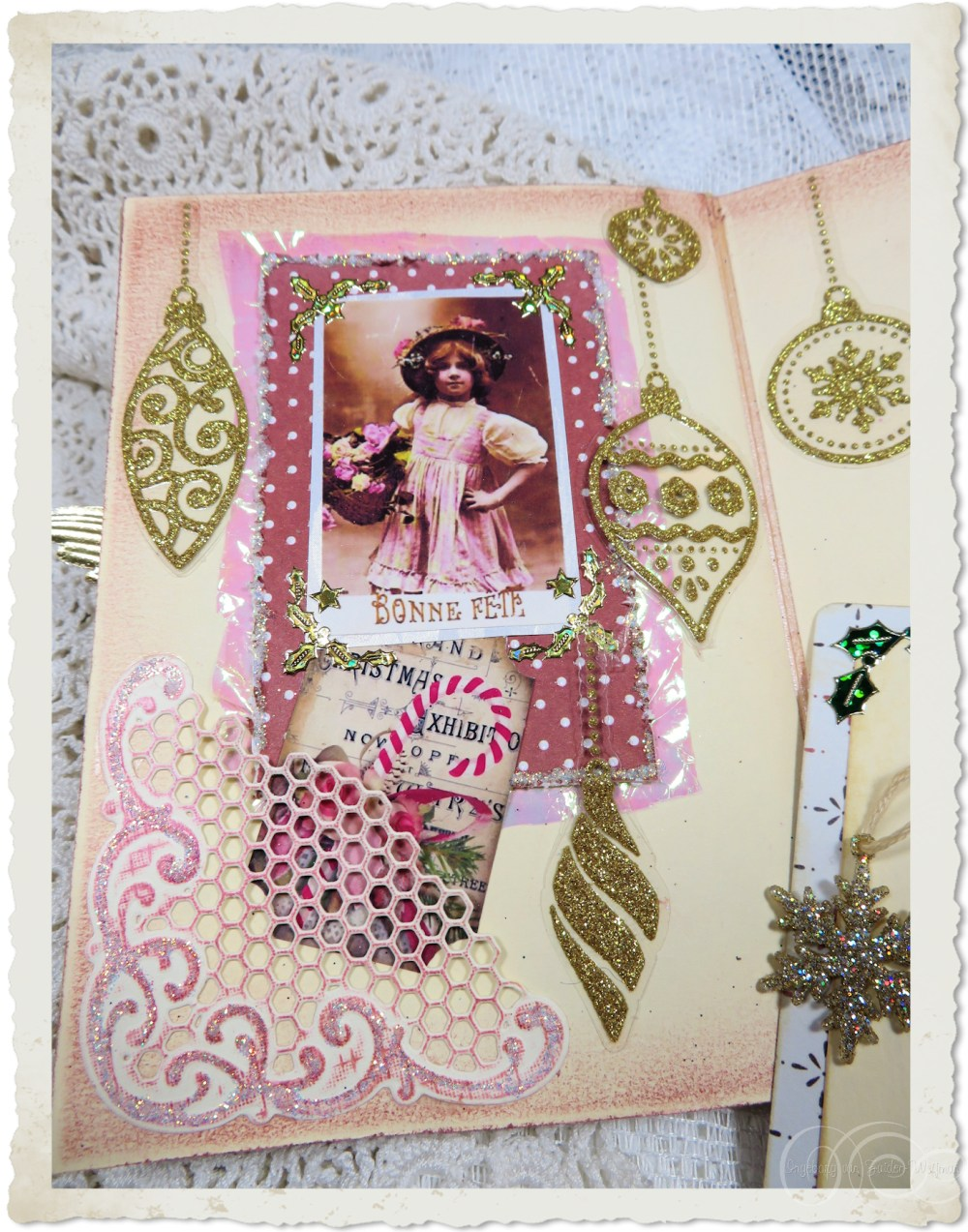 Vintage Christmas girl on the first inside page with pocket and golden ball stickers