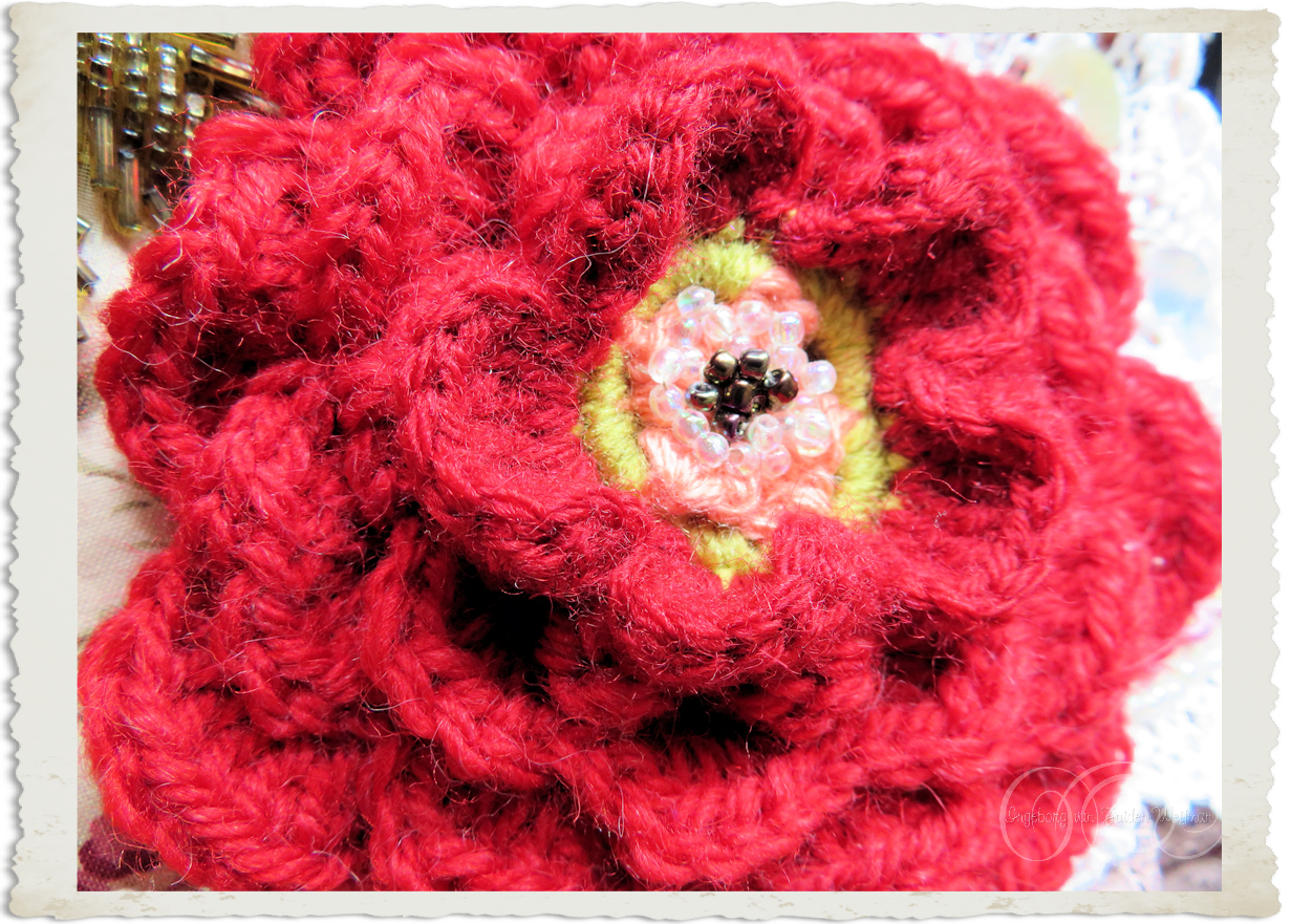 Handmade red crochet rose by Ingeborg van Zuiden