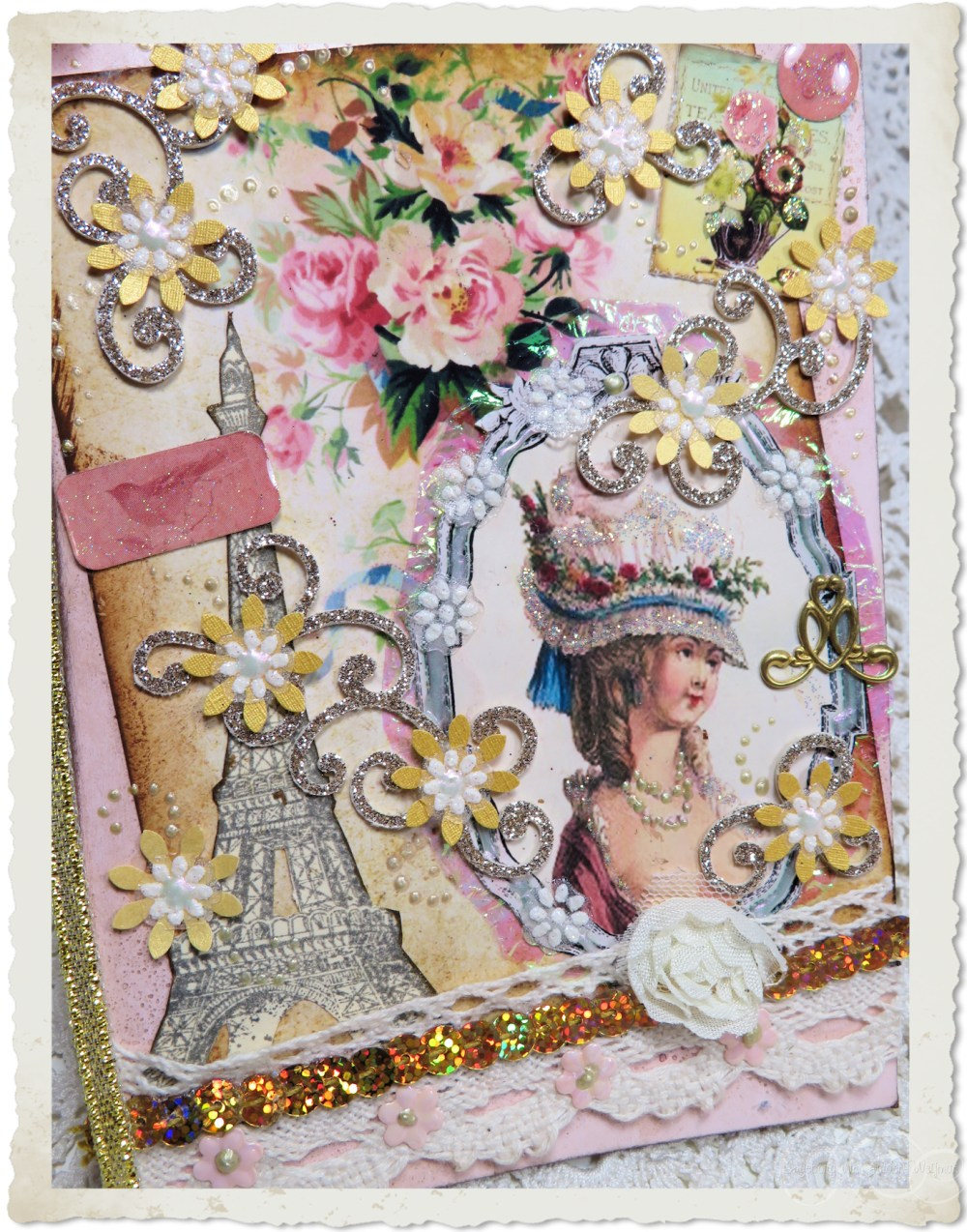 Details of handmade card Marie en Paris with punch flowers and lots of glitter