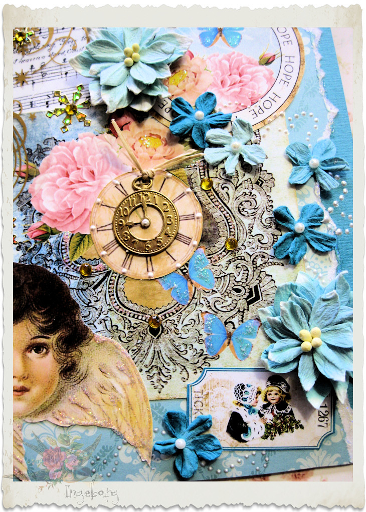 Details of blue Petaloo flowers on handmade Christmas card