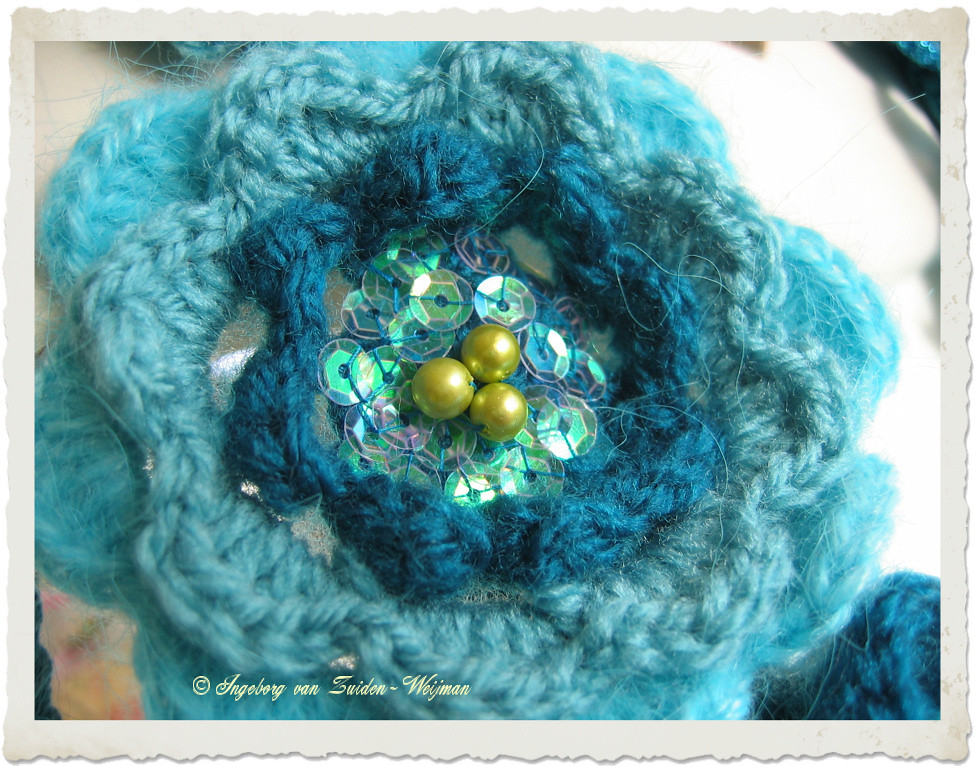 Crochet rose with iridescent sequins by Ingeborg van Zuiden