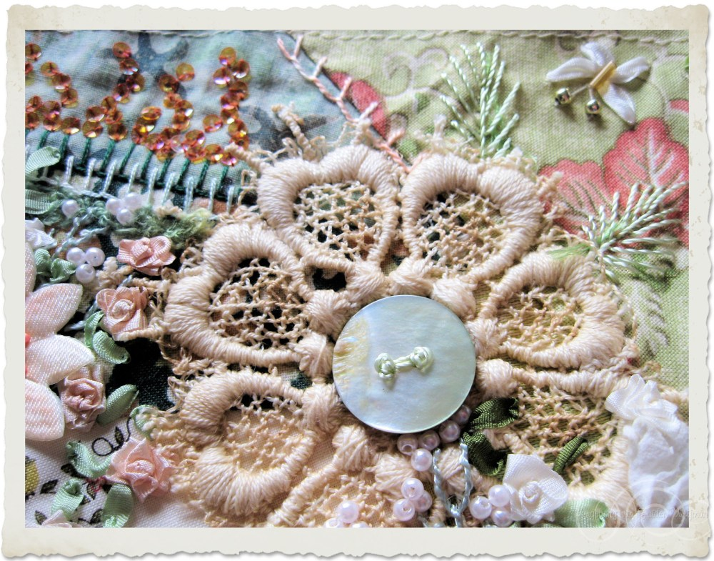 Lace applique with mop button and embroidery leaves