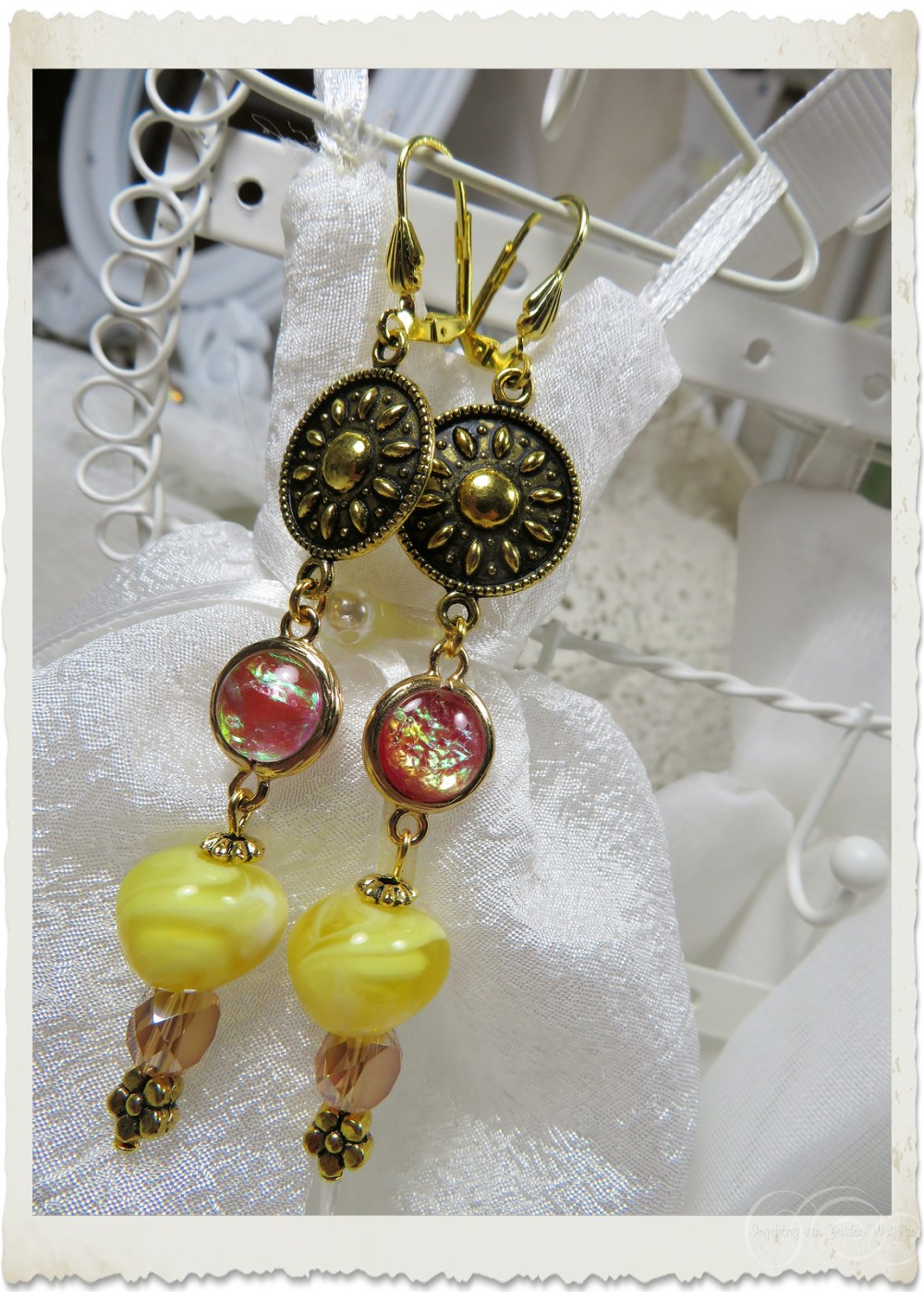Handmade ornamental dangling earrings with opal findings