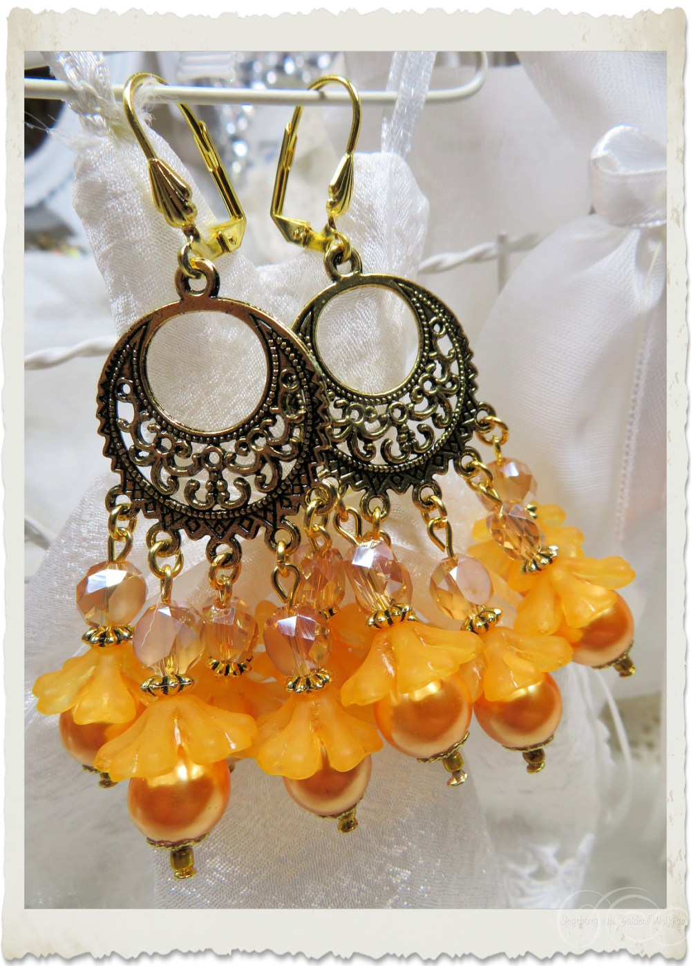 Handmade orange yellow floral chandelier earrings by Ingeborg van Zuiden