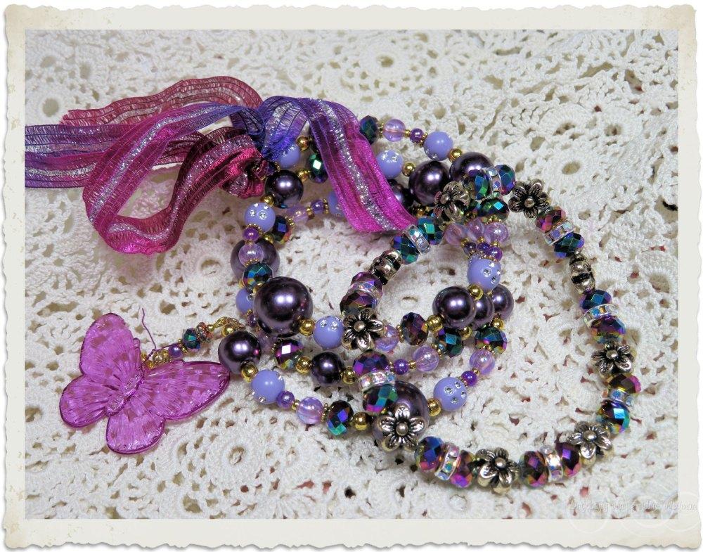 Handmade purple bracelets with ribbon and strass by Ingeborg van Zuiden