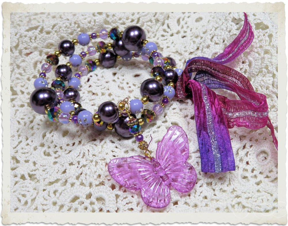 Memory wire bracelet with purple acrylic butterfly and ribbons