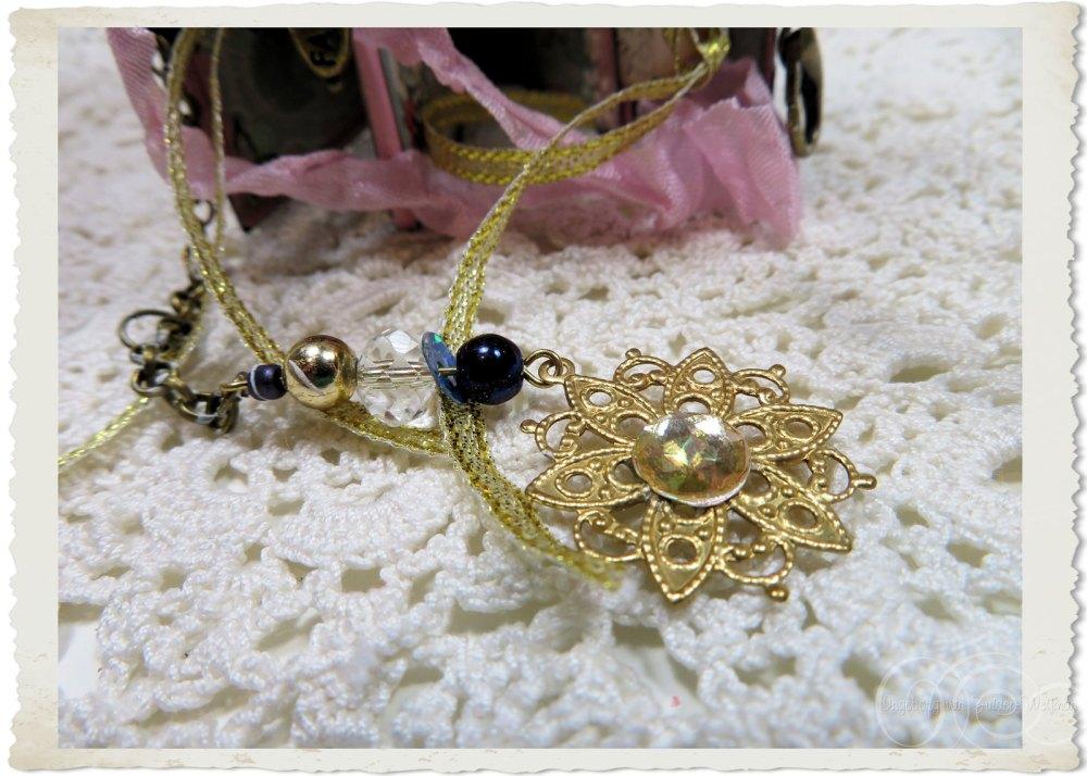 Handmade beaded dangle with filligree star flower