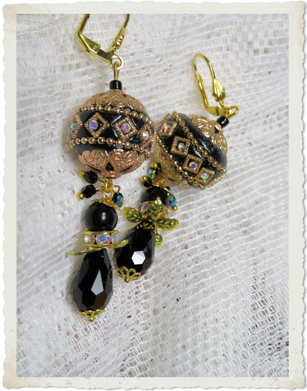Handmade black gold earrings with strass by Ingeborg van Zuiden