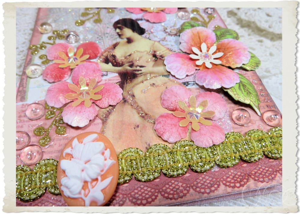 Details of pastel pink flowers with gold ribbon