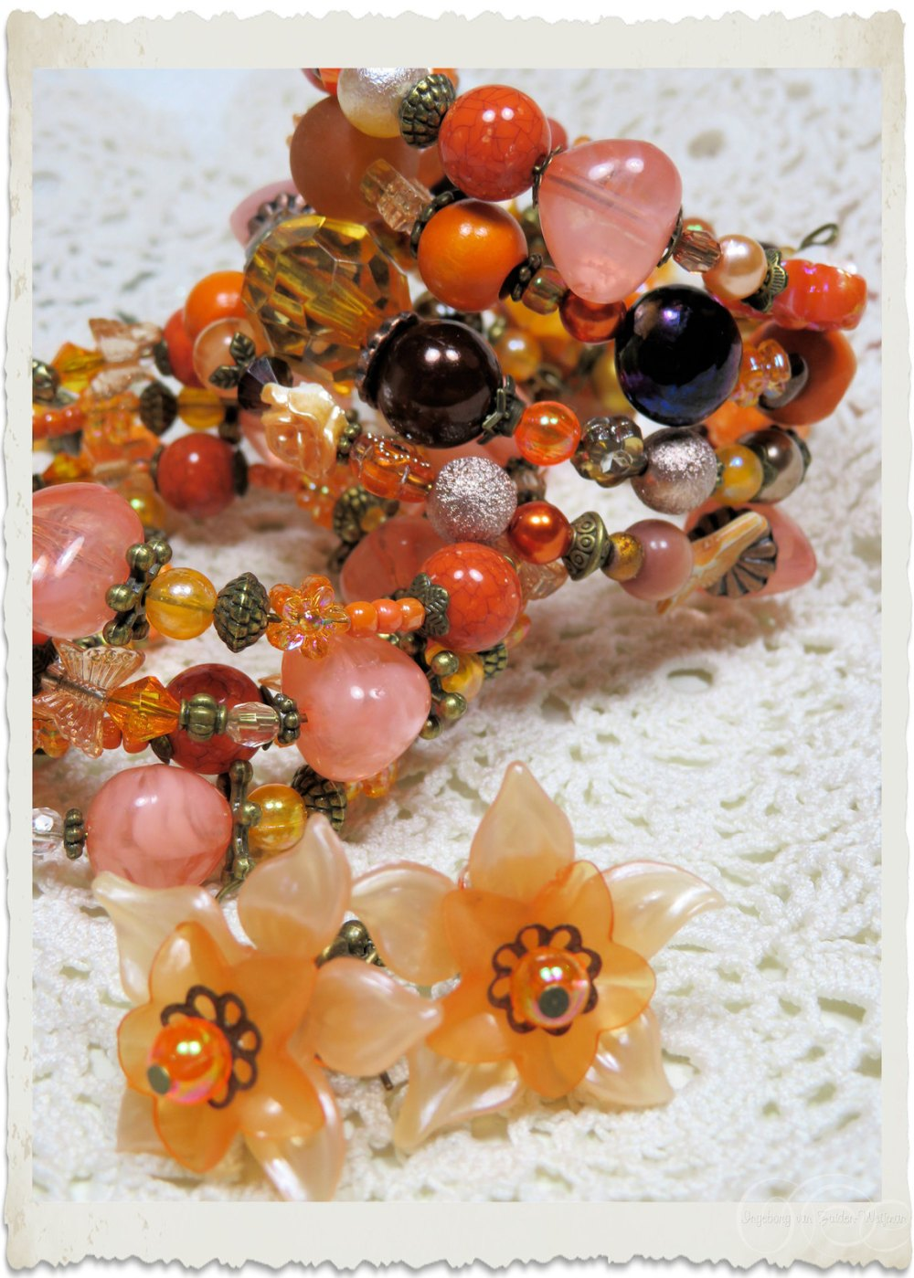 Orange floral earrings by Ingeborg