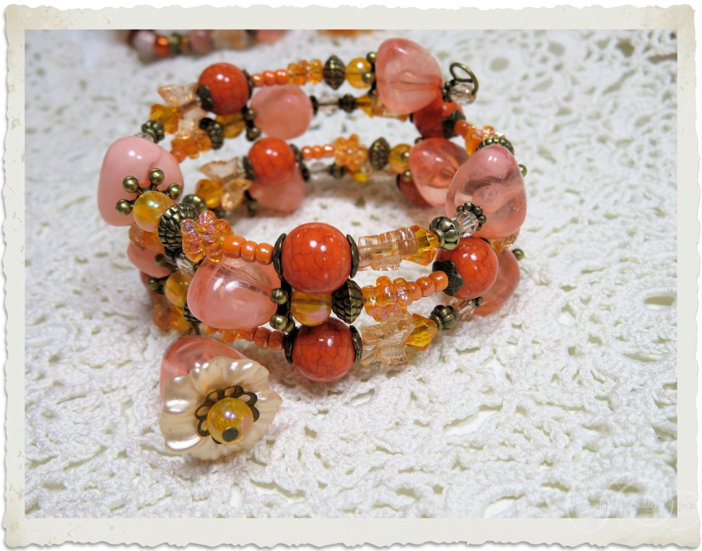 Orange peach floral memory wire bracelet by Ingeborg van Zuiden