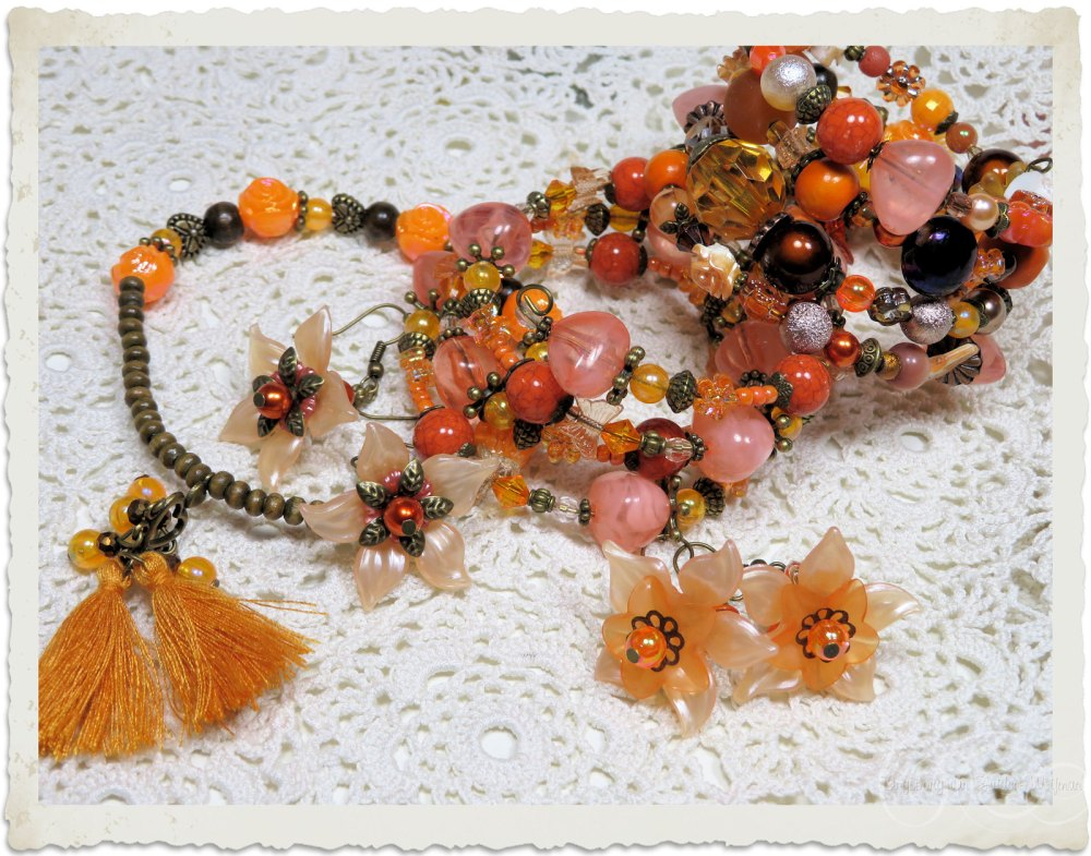 Set of three bracelets in orange and peach with matching earrings