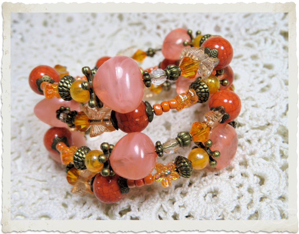 Jewelry by Ingeborg van Zuiden in orange and peach