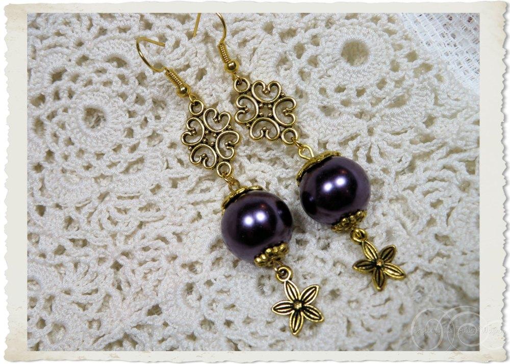 Gold toned ornamental star flower earrings by Ingeborg va nZuiden