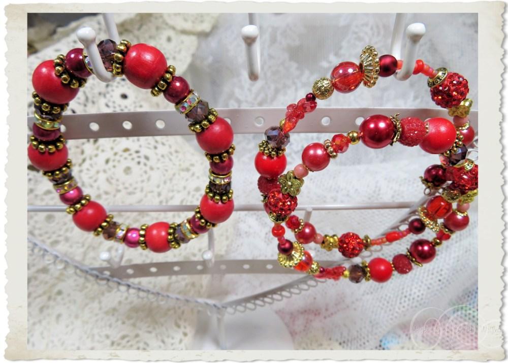 Handmade red bracelets by Ingeborg van Zuiden