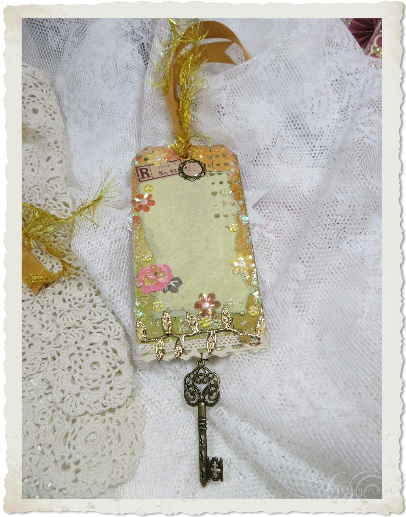 Backside of butterfly and roses tag
