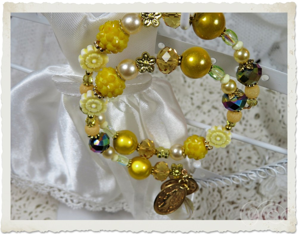Details of memory wire bracelet with yellow miracle beads