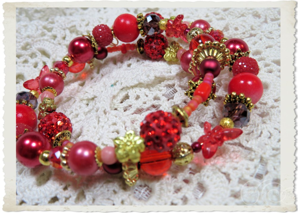 Details of Red pearl memory wire bracelet with shamballa beads