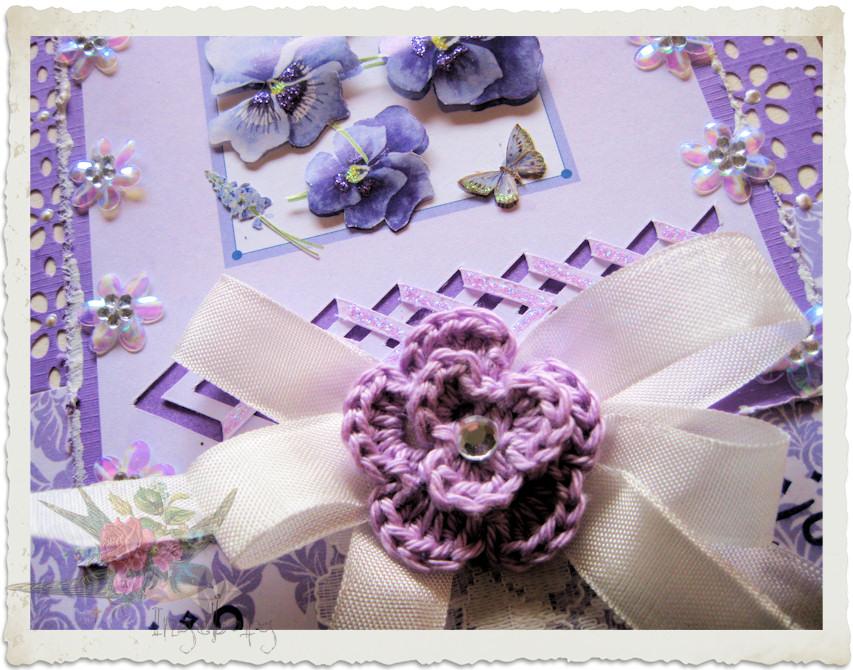 Details of crochet flower in purple