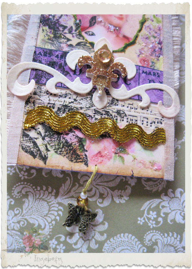 Details of butterfly charm dangle on a tag