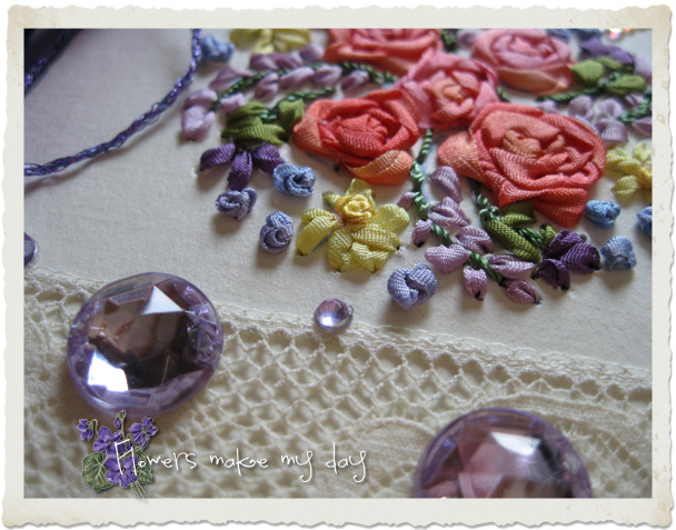 Bling stones , lace and embroidery on a handmade spring card