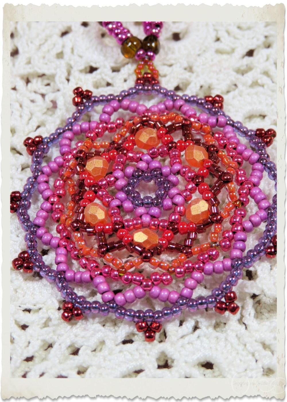 Handmade bead weaving handbag ornament hanger in pink orange and lilacs