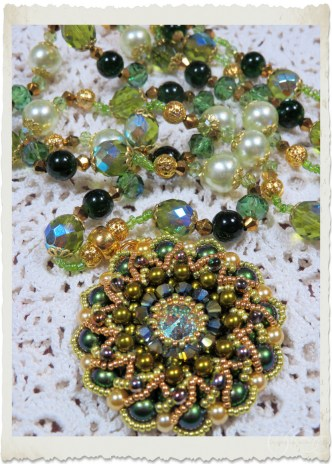 Details of handmade baroque bling bling pendant with beaded necklace